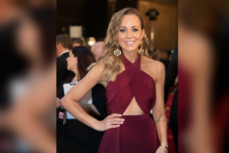 Carrie Bickmore dons a plum tinged red gown and poses with her hand on her hip in crown casino