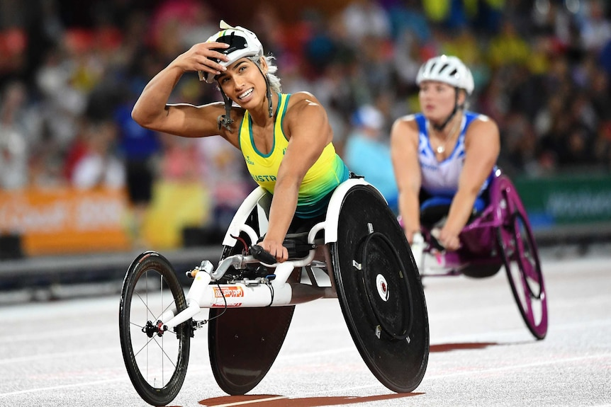 Madison de Rozario of Australia reacts after crossing the finish line.