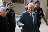 Former Malaysian Prime Minister Najib Razak arrives at High Court of Malaya in Kuala Lumpur