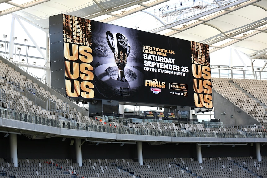 A large electronic sign promoting the AFL grand final at Perth Stadium.