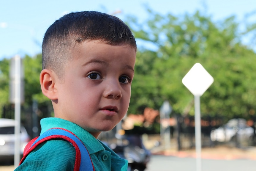 A photo portrait of Elijah on his first day of kindergarten.