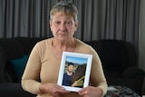 Rosemary Harwood holds a photo of her transgender daughter Marjorie.-