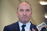 Barnaby Joyce gestures for microphones to get out of his face