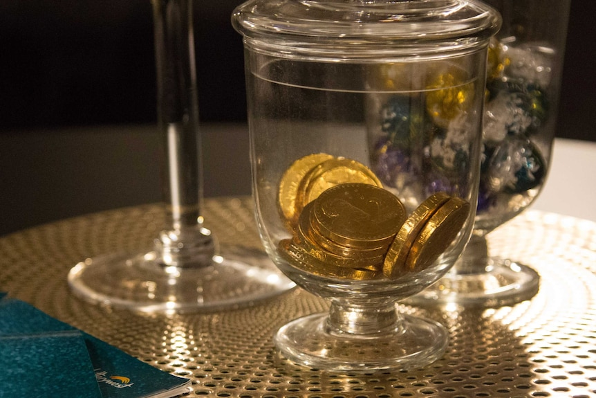 Gold coin chocolate in a jar