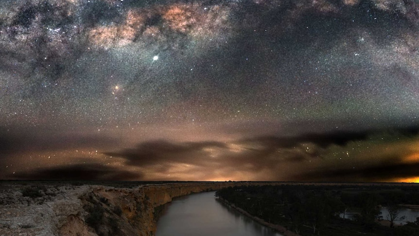 A body of water captured under the night sky.