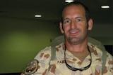 Man in uniform smiling