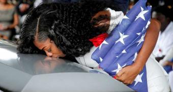 Pregnant widow Myeshia Johnson kisses the casket holding her fallen solider husband, La David Johnson.