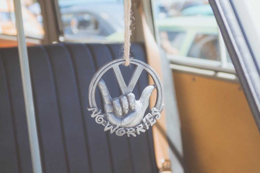 No worries pendant hanging in a car