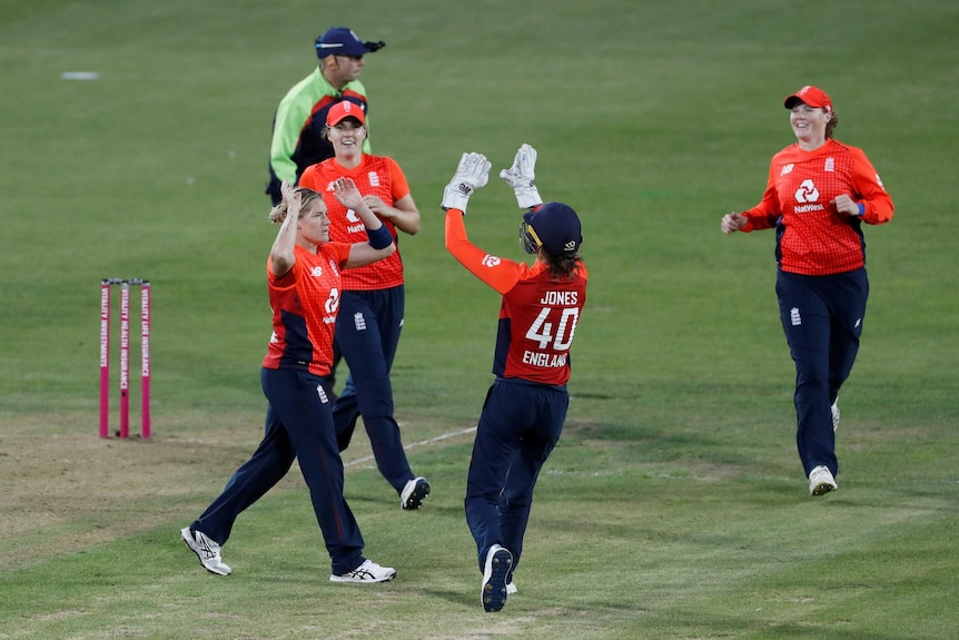 The bowler and wicketkeeper run in to exchange high-five after a wicket in the Women's Ashes.
