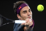 Roger Federer swings a forehand at the tennis ball during his Australian Open clash with Filip Krajinovic.