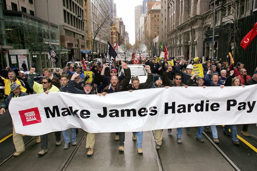 Trade unionists march through the streets of Melbourne calling on James Hardie to compensate asbestos victims.