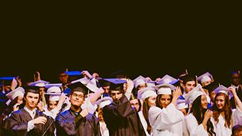 University graduates in academic dress.