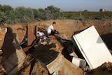 Palestinian boy inspects the damage after an Israeli retaliatory air strike