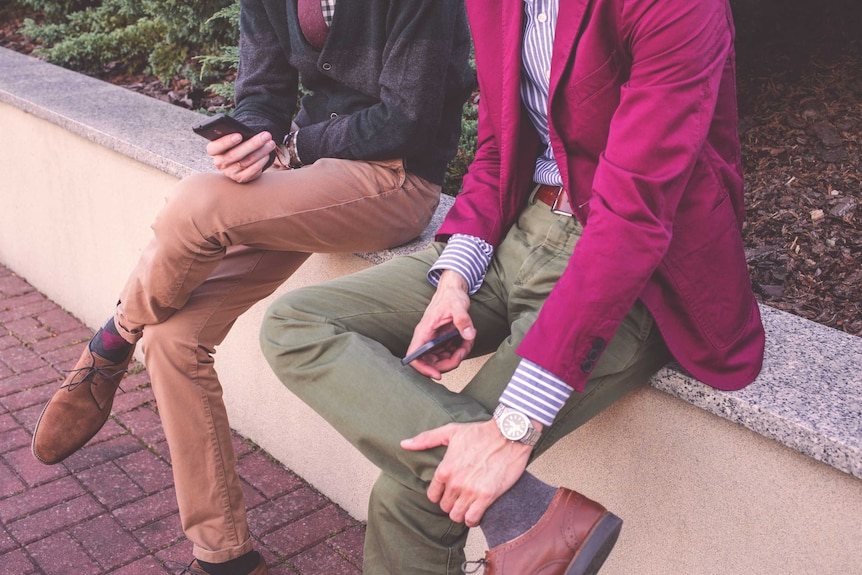 Two men wearing smart casual work wear and shoes to depict a office appropriate wardrobe for men.