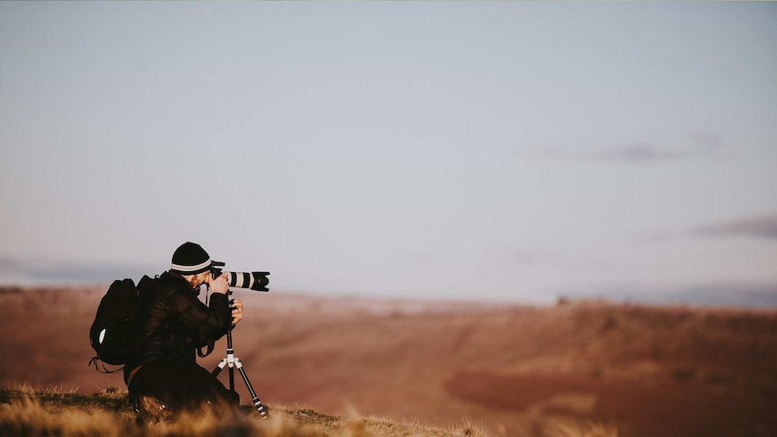 Photographer out in the wilderness for a story about finding a career that matches your personality