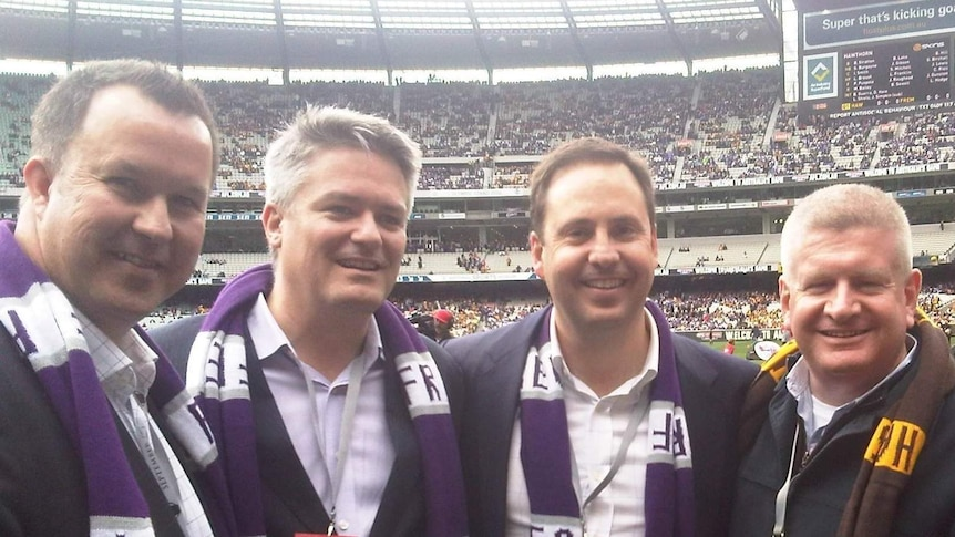 Steve Ciobo (second from right) has has defended charging taxpayers to attend the 2013 AFL grand final.