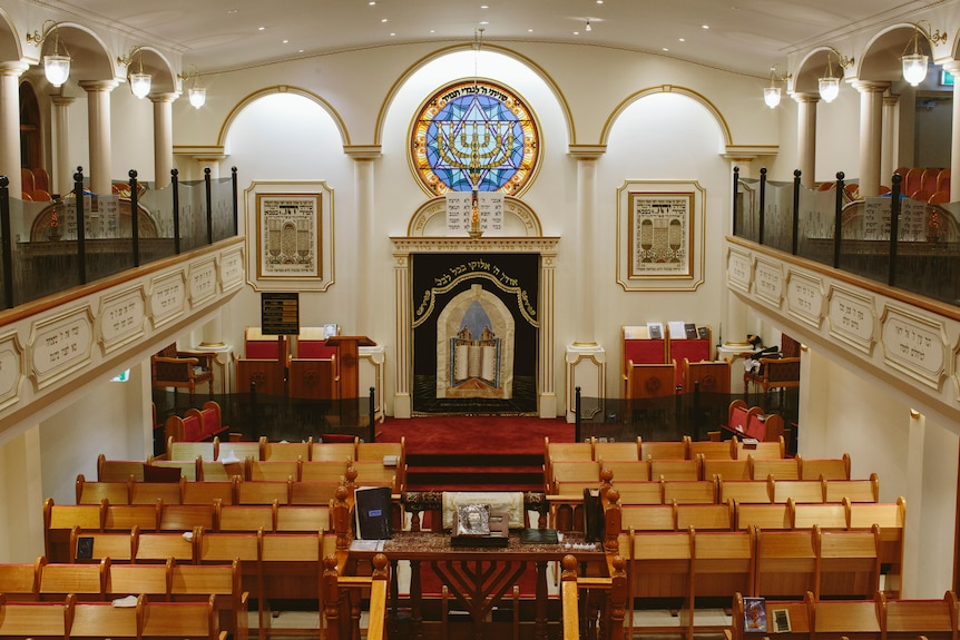 Inside of Sydney's Sephardi Synagogue, which features a stained glass window.