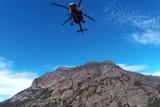 Helicopter overhead during bushwalker rescue at Freycinet National Park.