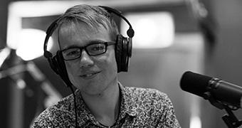 Jerrah Patston with headphones in a studio
