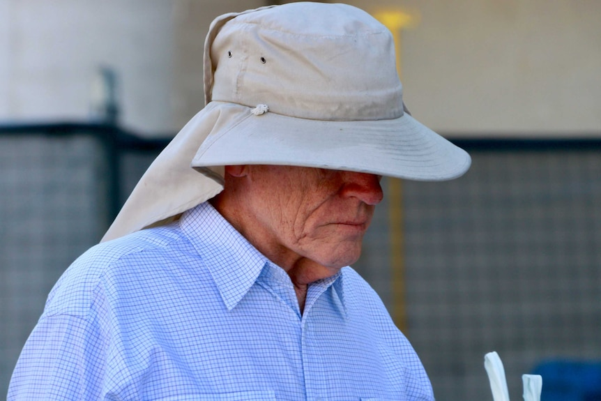 Former public servant David Eastman, wearing a large hat, arrives at court.