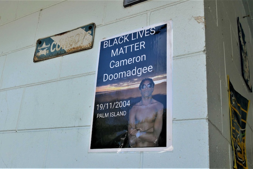 A laminated sign reads Black Lives Matter Cameron Doomadgee 19/11/2004 Palm Island