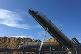Wood chips being offloaded from a truck