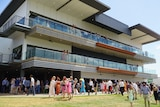 The Darwin Turf Club grandstand packed with spectators on a Darwin race day.