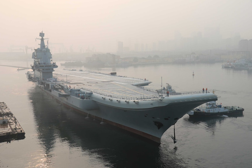 China's first home-built aircraft carrier leaves port.