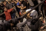 Police clash with protesters during a demonstration at El Prat airport