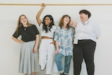 Four people standing against a wall in a story about the complex nature of body confidence.