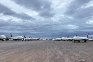 Rows of planes lined up in the desert.