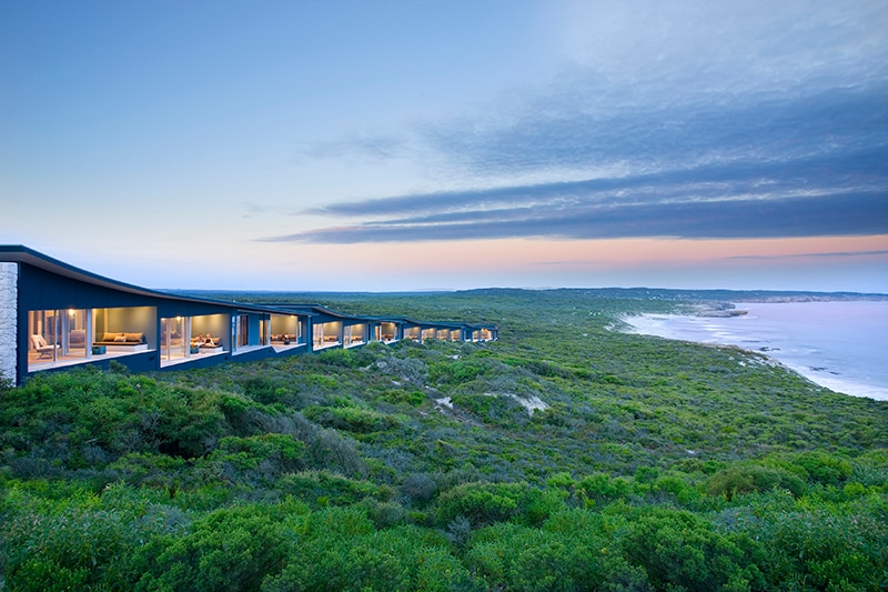 Luxury accommodation nestled in bushland, right on the coast.