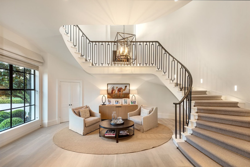 A sitting area with a spiral staircase.