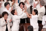 Democratic female members of Congress cheer after US President Donald Trump said there are more women in Congress than ever.