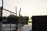 Water overflows from a canal in the Melbourne suburb of Gardenvale.