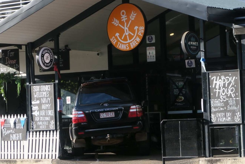 A car is seen crashed into the front doors of a pub — Six Tanks Brew Co.