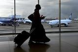 An unidentifiable woman walks through Sydney airport