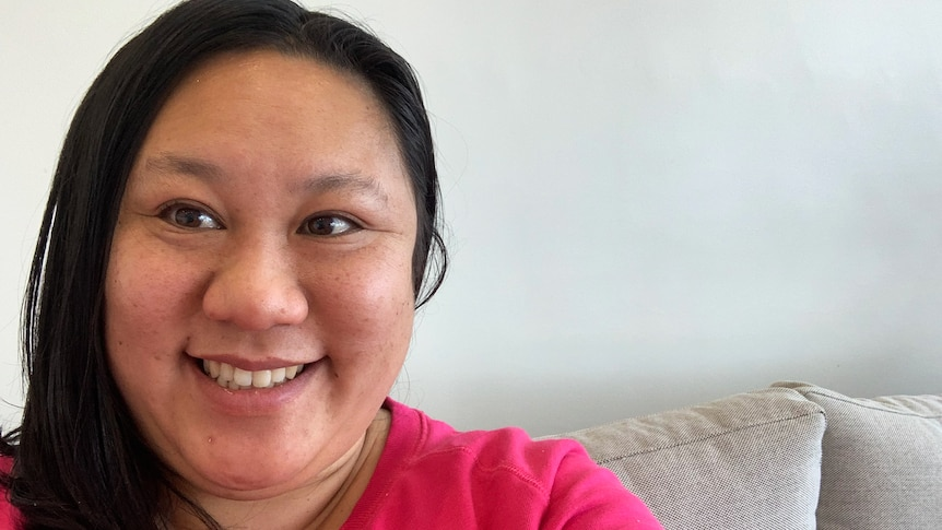 Portrait of Anne Lin smiling in a story about what it's like living with schizophrenia.