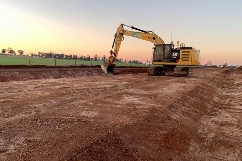 A digger working on constructing a rail track.