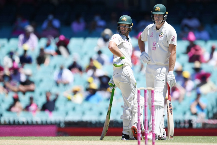Australia batsmen Tim Paine (left) and Cameron Green talk near the pitch between overs during a Test at the SCG.