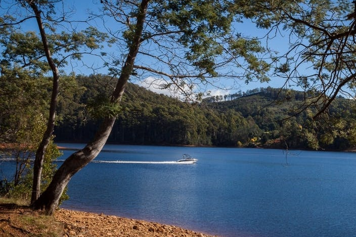 A lake with hills behind.