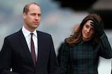 Prince William, Duke of Cambridge and Catherine, Duchess of Cambridge, walk together.