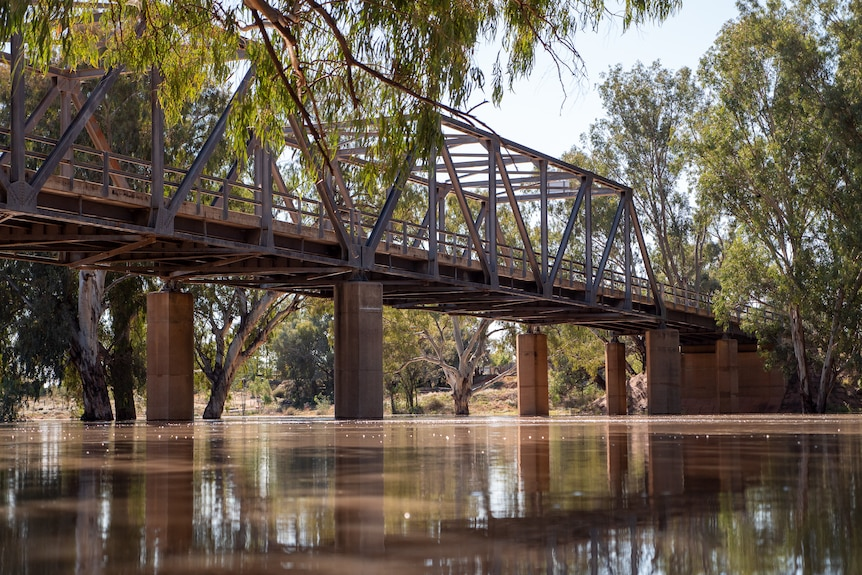The large metal bridge at Louth, with floodwaters flowing beneath it, April 2021.