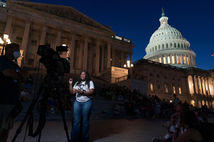 Rep. Cori Bush, D-Mo., speaks during an interview as she camps outside the U.S. Capitol