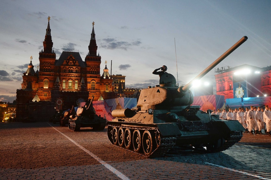 Soviet World War II T-34 tanks drive during VE Day celebrations