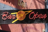 A black 'Bar Open' sign outside the Mustang Bar in Perth.