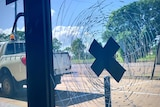 A smashed window taped with gaffer tape