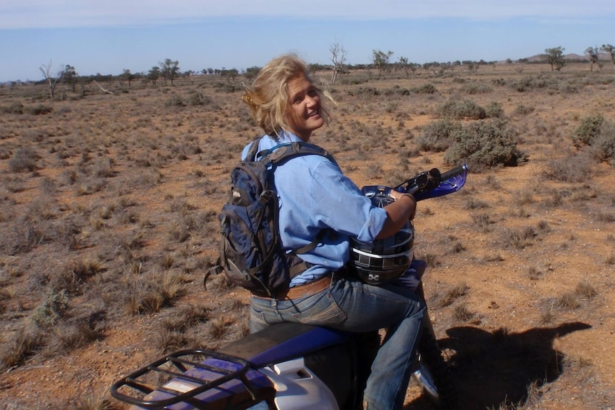 Tanja Ebert smiles while on a motorbike.