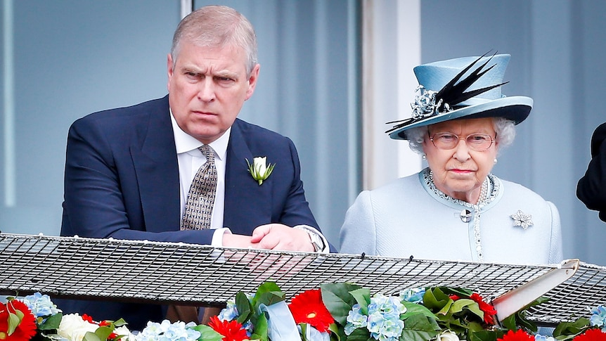 Prince Andrew and Queen Elizabeth looking serious as they stand at a balcony decorated with flowers