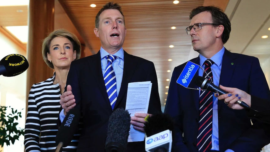 Government ministers Michaelia Cash, Christian Porter and Alan Tudge speak to the media in Canberra.